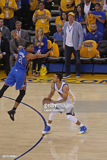 Stephen Curry of the Golden State Warriors looks to shoot the ball while guarded by Andre Roberson of the Oklahoma City Thunder in Game Five of the...