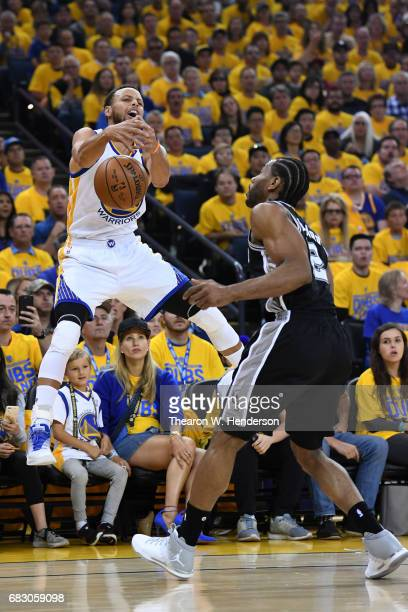 Stephen Curry of the Golden State Warriors loses control of the ball during Game One of the NBA Western Conference Finals against the San Antonio...