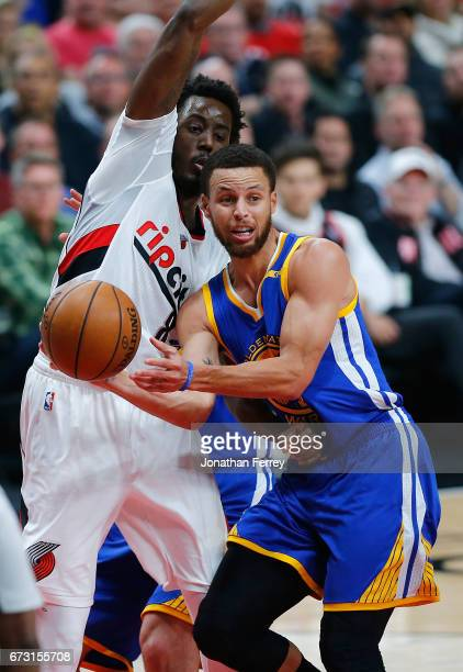 Stephen Curry of the Golden State Warriors passes the ball against Al Farouq Aminu of the Portland Trail Blazers during Game Four of the Western...