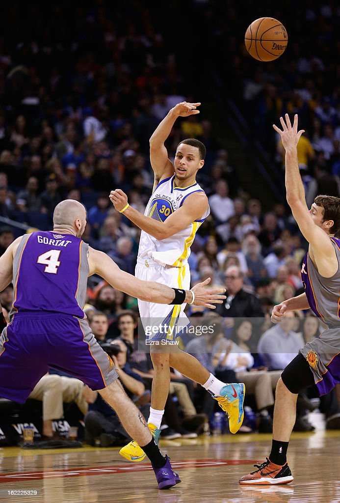 Stephen Curry #30 of the Golden State Warriors passes the ball during their game against the Phoenix Suns at Oracle Arena on February 20, 2013 in Oakland, California.