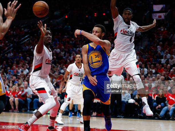 Stephen Curry of the Golden State Warriors passes the ball over Al Farouq Aminu of the Portland Trail Blazers during Game Three of the Western...