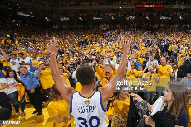 Stephen Curry of the Golden State Warriors points to the fans after winning Game Five of the 2017 NBA Finals against the Cleveland Cavaliers on June...