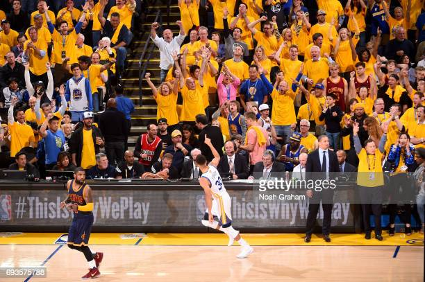 Stephen Curry of the Golden State Warriors points to the fans and runs up court after hitting a three point basket against the Cleveland Cavaliers in...