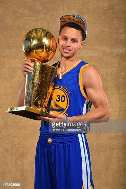 Stephen Curry of the Golden State Warriors poses for a portrait with the Larry O'Brien trophy after defeating the Cleveland Cavaliers in Game Six of...