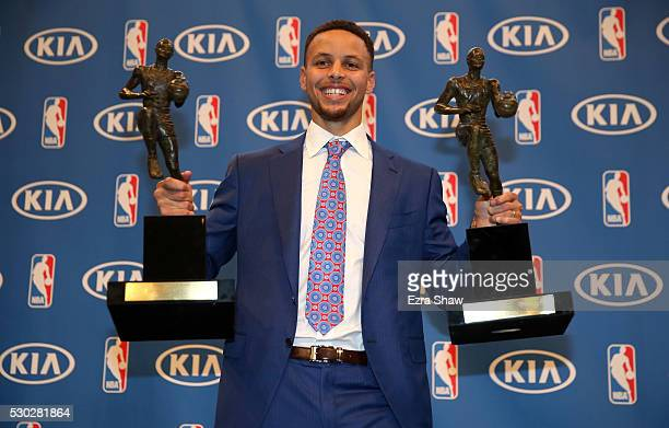 Stephen Curry of the Golden State Warriors poses with his backtoback NBA Most Valuable Player Awards following a press conference at ORACLE Arena on...