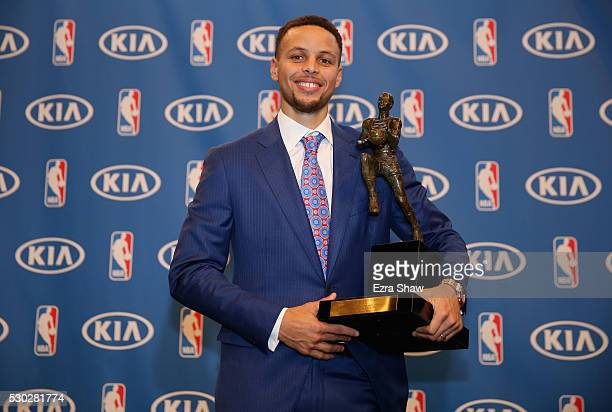 Stephen Curry of the Golden State Warriors poses with his NBA Most Valuable Player Award following a press conference at ORACLE Arena on May 10 2016...