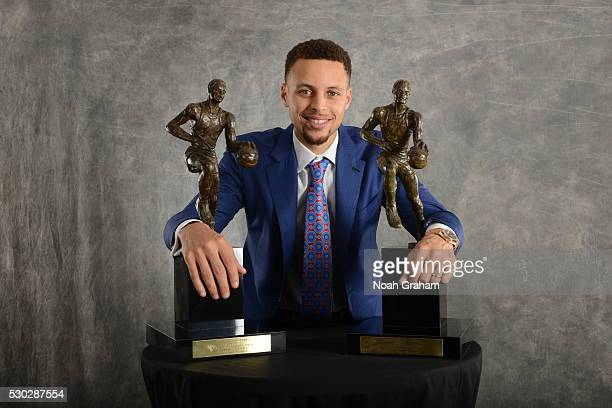 Stephen Curry of the Golden State Warriors poses with the Maurice Podoloff Trophy after Curry was awarded the 201516 Kia Most Valuable Player Award...