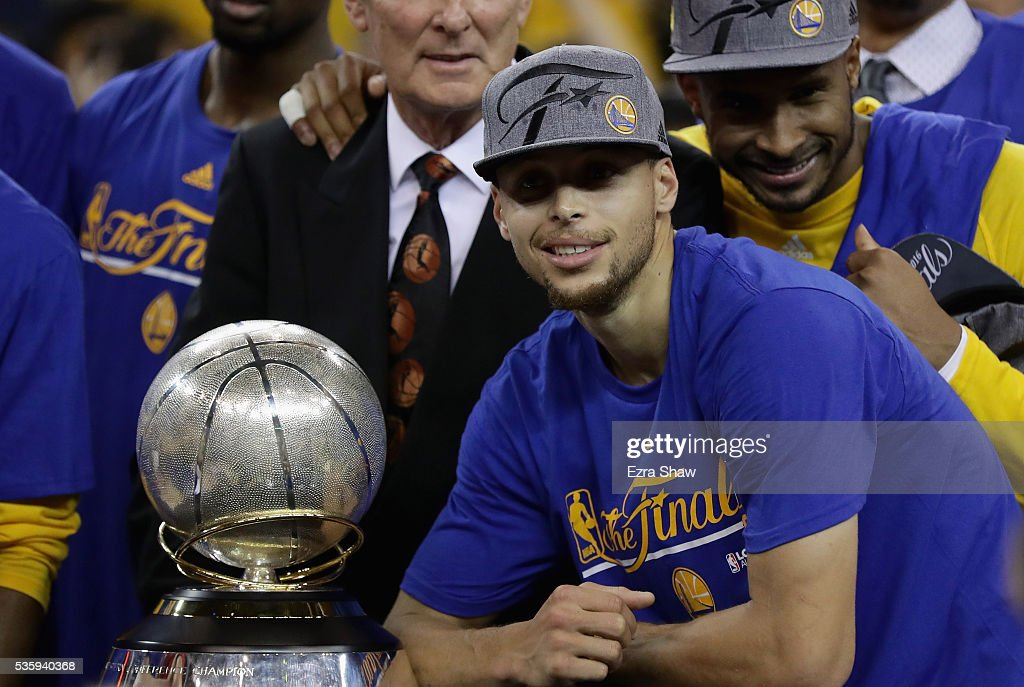 Stephen Curry #30 of the Golden State Warriors poses with the Western Conference Trophy they beat the Oklahoma City Thunder in Game Seven of the Western Conference Finals during the 2016 NBA Playoffs at ORACLE Arena on May 30, 2016 in Oakland, California.