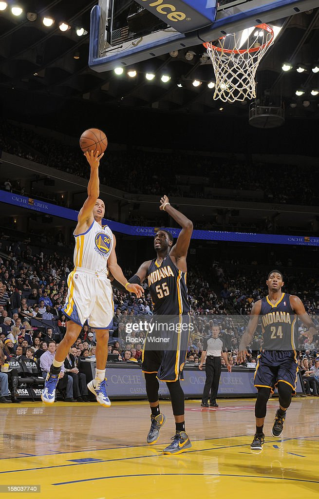 Stephen Curry #30 of the Golden State Warriors puts up a shot against <a gi-track='captionPersonalityLinkClicked' href=/galleries/search?phrase=Roy+Hibbert&family=editorial&specificpeople=725128 ng-click='$event.stopPropagation()'>Roy Hibbert</a> #55 of the Indiana Pacers on December 1, 2012 at Oracle Arena in Oakland, California.