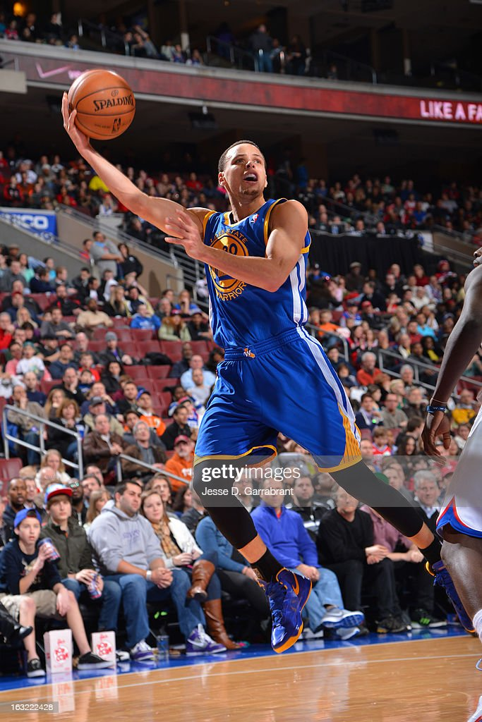 Stephen Curry #30 of the Golden State Warriors puts up a shot against the Philadelphia 76ers on March 2, 2013 at the Wells Fargo Center in Philadelphia, Pennsylvania.