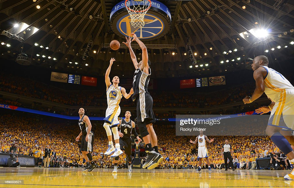 Stephen Curry #30 of the Golden State Warriors puts up a shot in the lane against Tim Duncan #21 of the San Antonio Spurs in Game Four of the Western Conference Semifinals during the 2013 NBA Playoffs on May 12, 2013 at Oracle Arena in Oakland, California.