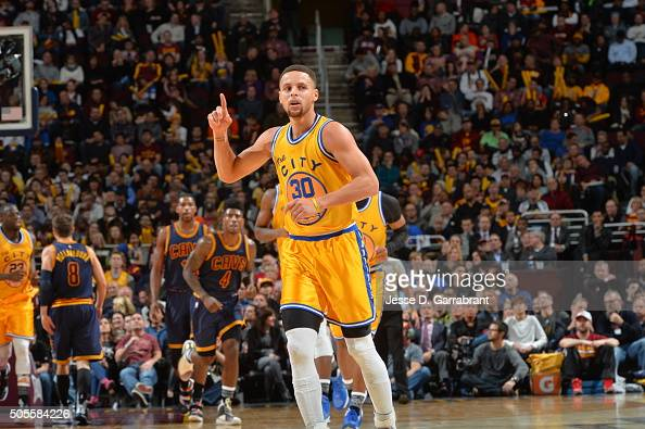 Stephen Curry of the Golden State Warriors raises his hand during a break in the action against the Cleveland Cavaliers on January 18 2016 at Quicken...
