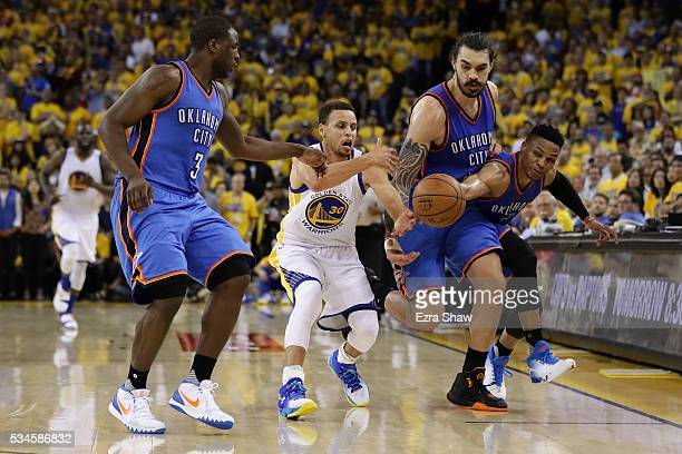 Stephen Curry of the Golden State Warriors reaches for a loose ball against Dion Waiters Steven Adams and Russell Westbrook of the Oklahoma City...