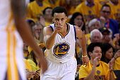 Stephen Curry of the Golden State Warriors reacts after a basket in the first quarter against the Houston Rockets during game two of the Western...