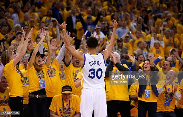 Stephen Curry of the Golden State Warriors reacts after a basket in the fourth quarter against the Houston Rockets during game two of the Western...