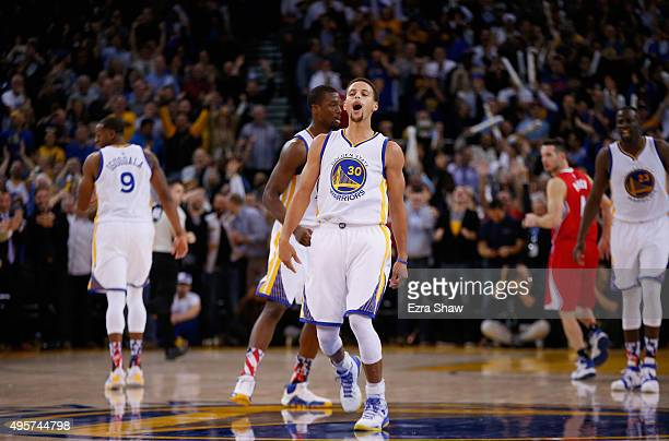 Stephen Curry of the Golden State Warriors reacts after he made a basket over DeAndre Jordan in the fourth quarter at ORACLE Arena on November 4 2015...