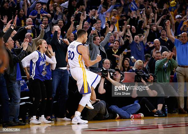Stephen Curry of the Golden State Warriors reacts after he made a halfcourt shot to end the first half of their game against the Indiana Pacers at...