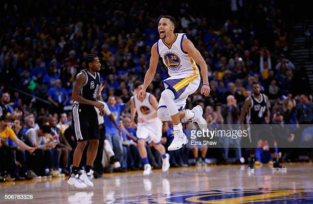 Stephen Curry of the Golden State Warriors reacts after he made a shot against the San Antonio Spurs in the third quarter at ORACLE Arena on January...