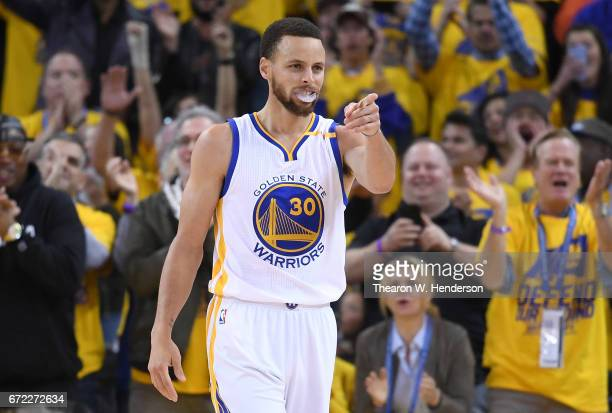 Stephen Curry of the Golden State Warriors reacts after he scored a basket against the Portland Trail Blazers in the fourth quarter during Game One...