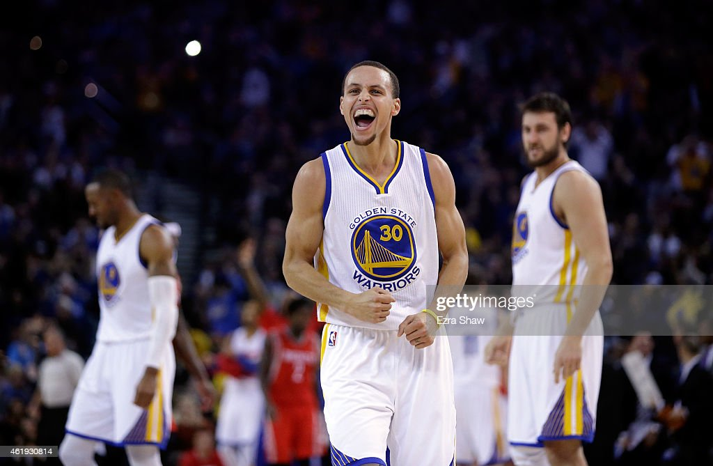 Stephen Curry of the Golden State Warriors reacts after he stole the ball and then made a basket in the first half of their game against the Houston...