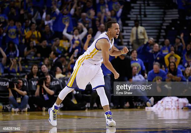 Stephen Curry of the Golden State Warriors reacts after he threw a long down court assist to Klay Thompson who made a threepoint basket against the...