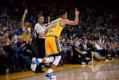 Stephen Curry of the Golden State Warriors reacts after hitting a threepoint shot against the Los Angeles Lakers during an NBA basketball game at...