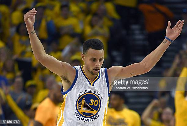 Stephen Curry of the Golden State Warriors reacts after hitting a threepoint shot against the Houston Rockets in the second quarter in Game One of...