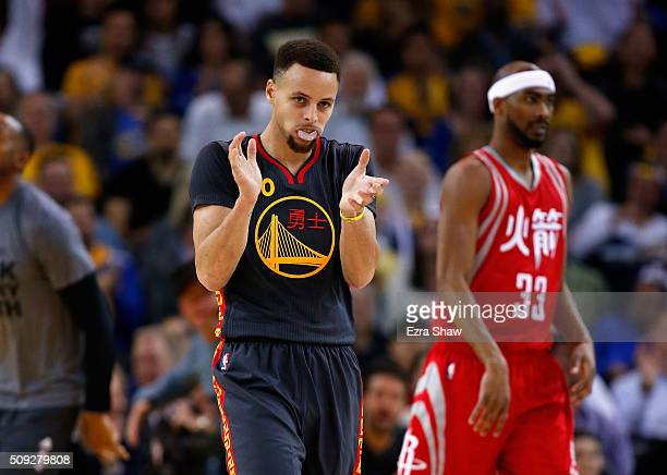 Stephen Curry of the Golden State Warriors reacts after making a basket in the first quarter of their game against the Houston Rockets at ORACLE...
