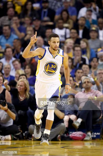 Stephen Curry of the Golden State Warriors reacts after making a basket against the Dallas Mavericks at ORACLE Arena on November 9 2016 in Oakland...