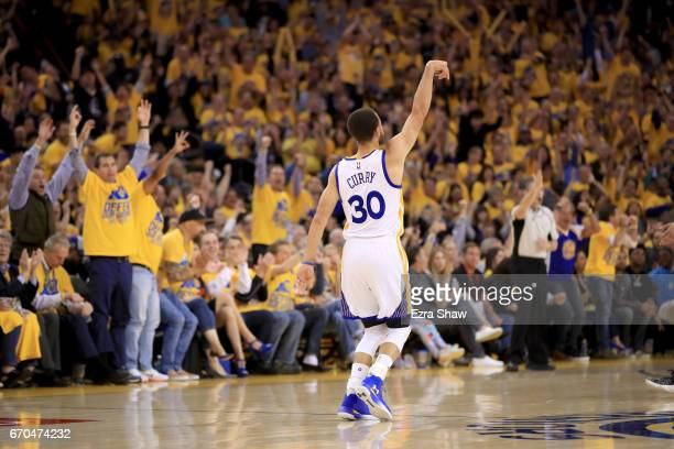 Stephen Curry of the Golden State Warriors reacts after making a threepoint basket during their game against the Portland Trail Blazers in Game Two...