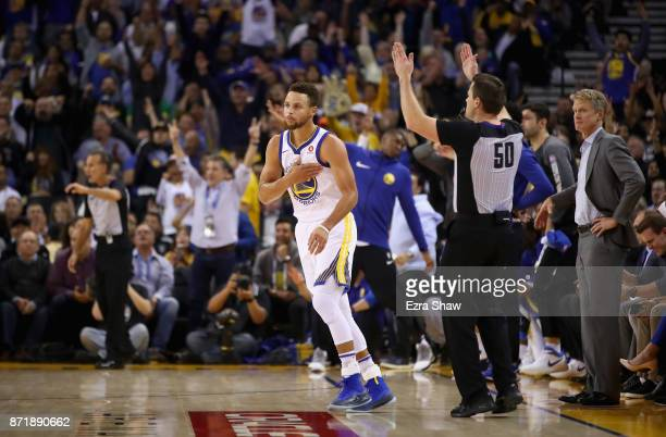 Stephen Curry of the Golden State Warriors reacts after making a threepoint basket against the Minnesota Timberwolves at ORACLE Arena on November 8...