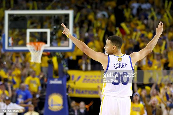 Stephen Curry of the Golden State Warriors reacts after scoring a threepoint basket against the Cleveland Cavaliers in Game 7 of the 2016 NBA Finals...