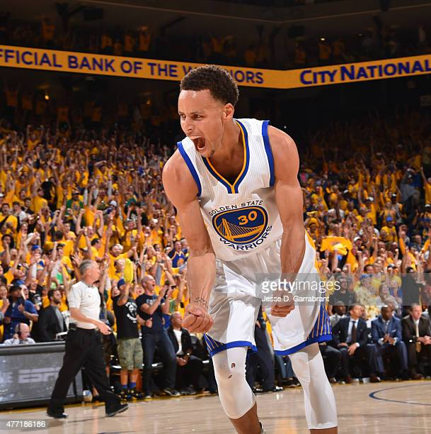 Stephen Curry of the Golden State Warriors reacts after winning the game against the Cleveland Cavaliers at the Oracle Arena During Game Five of the...