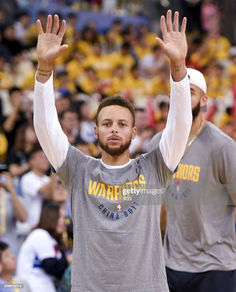 Stephen Curry #30 of the Golden State Warriors reacts during fan day as part of 2017 NBA Global Games China at the Oriental Sports Center on October 7, 2017 in Shanghai, China.