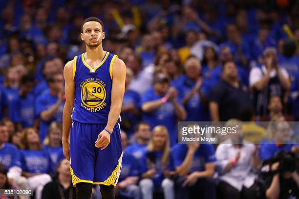 Stephen Curry of the Golden State Warriors reacts during the fourth quarter against the Oklahoma City Thunder in game six of the Western Conference...