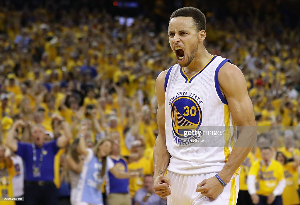Stephen Curry of the Golden State Warriors reacts in the third quarter of Game Seven of the Western Conference Finals against the Oklahoma City...