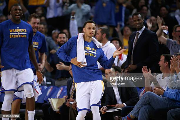 Stephen Curry of the Golden State Warriors reacts on the bench after Leandro Barbosa made a basket and was fouled during their game against the...