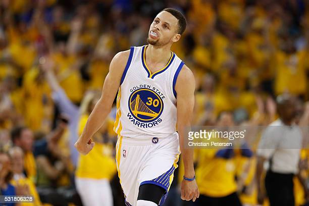 Stephen Curry of the Golden State Warriors reacts to a basket against the Oklahoma City Thunder during game one of the NBA Western Conference Final...