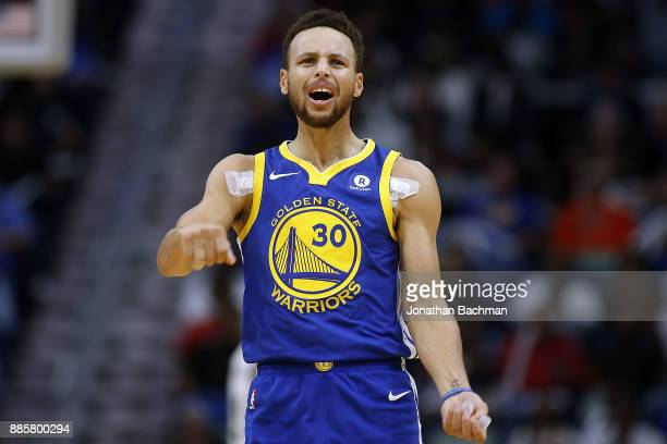 Stephen Curry of the Golden State Warriors reacts to a missed shot during the first half of a game against the New Orleans Pelicans at the Smoothie...