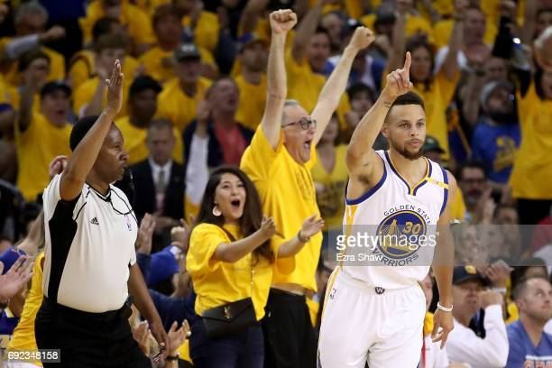 Stephen Curry of the Golden State Warriors reacts to a play against the Cleveland Cavaliers in Game 2 of the 2017 NBA Finals at ORACLE Arena on June...