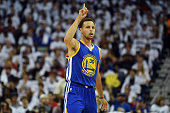 Stephen Curry of the Golden State Warriors reacts to a three point shot against the New Orleans Pelicans during Game Four in the first round of the...