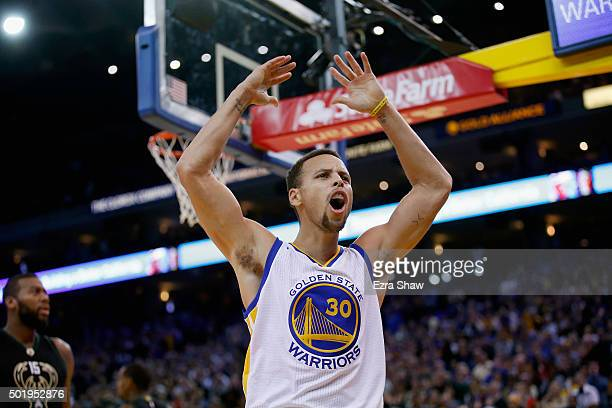 Stephen Curry of the Golden State Warriors reacts towards the crowd during their game against the Milwaukee Bucks at ORACLE Arena on December 18 2015...