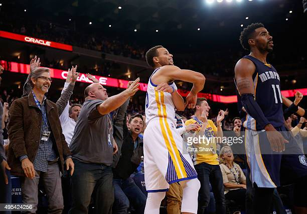 Stephen Curry of the Golden State Warriors reacts with the crowd after he made a threepoint basket over Mike Conley of the Memphis Grizzlies at...