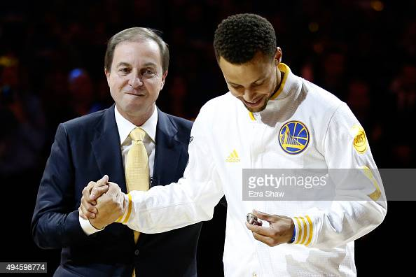 Stephen Curry of the Golden State Warriors receives his championship ring from owner Joe Lacob prior to their game against the New Orleans Pelicans...