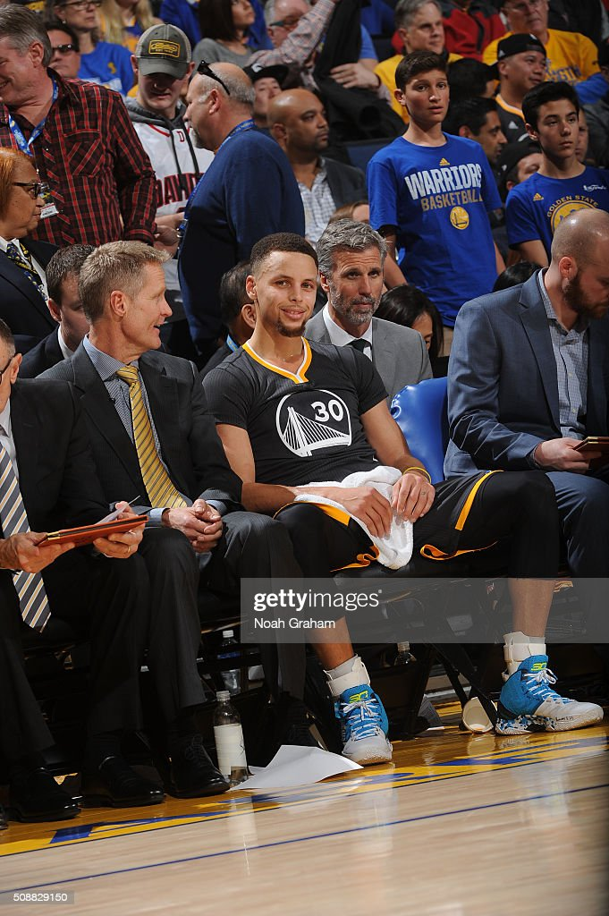 Stephen Curry #30 of the Golden State Warriors rests on the bench while facing the Oklahoma City Thunder on February 6, 2016 at Oracle Arena in Oakland, California.