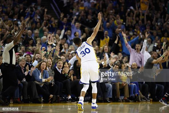 Stephen Curry of the Golden State Warriors retreats back down the court off balance after making a threepoint basket against the New Orleans Pelicans...