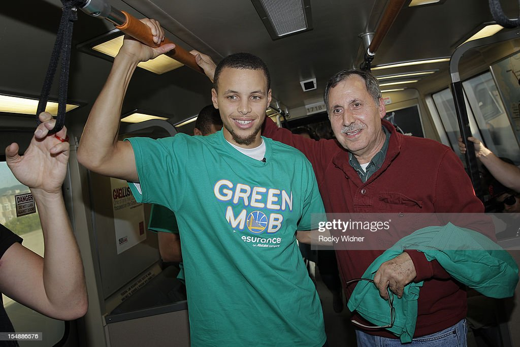 Stephen Curry of the Golden State Warriors rides BART with a fan on October 26, 2012 in Oakland, California.