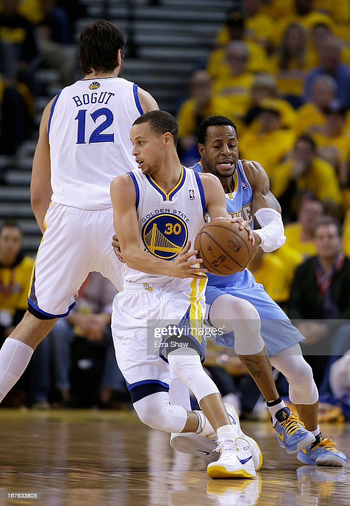 Stephen Curry #30 of the Golden State Warriors runs around a pick to try to get away from Andre Iguodala #9 of the Denver Nuggets during Game Three of the Western Conference Quarterfinals of the 2013 NBA Playoffs at ORACLE Arena on April 26, 2013 in Oakland, California.