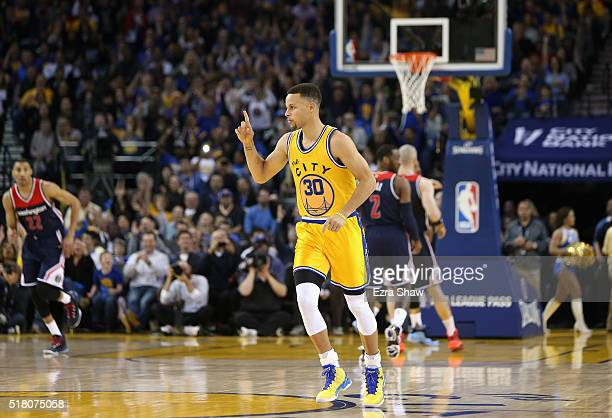 Stephen Curry of the Golden State Warriors runs back down court after making a threepoint basket against the Washington Wizards at ORACLE Arena on...