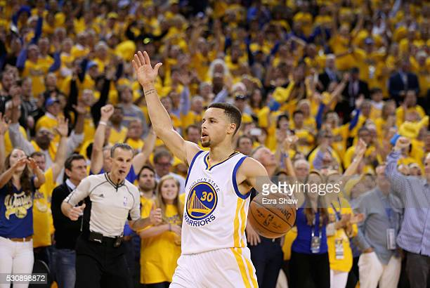 Stephen Curry of the Golden State Warriors runs down court during the finals seconds of their win over the Portland Trail Blazers in Game Five of the...